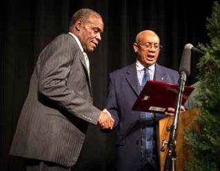 Rev. Pinkney gives award to actor Danny Glover at Justice Dinner in Benton Harbor last year.