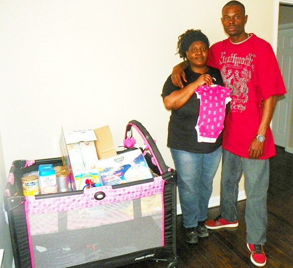 Tamikia McGruder and Arthur Simmons show crib and supplies ready for their baby Atjamino.