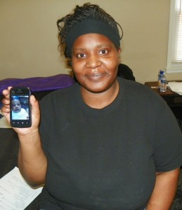 Tamikia McGruder shows cell phone photo of Atjamino.