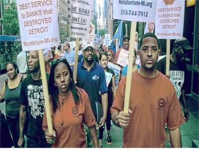 Marchers protest banks' role in destruction of Detroit.