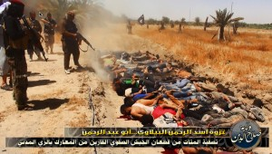 War crime: ISIS operatives execute police and soldiers in open field.