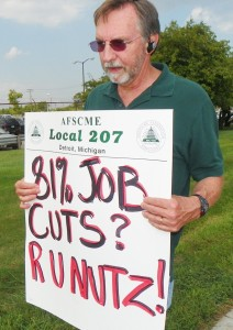 Mike Mulholland at informational picket at Huber facility in 2012. Not only does the Detroit bankruptcy plan affect retirees, it will end up seizing control of the Water Department. Hundreds have already been laid off and more are expected. The more city employees laid off, the greater the damage to city pension funds.