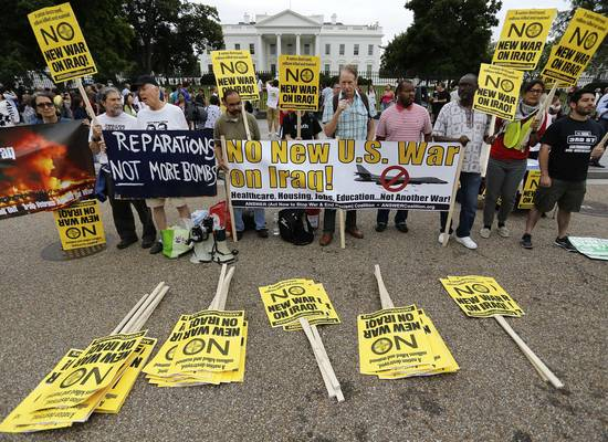 Protest outside White House. The U.S. announced that it has sent 300 troops to Iraq.