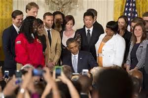 Pres. Barack Obama signs student debt re-financing order.