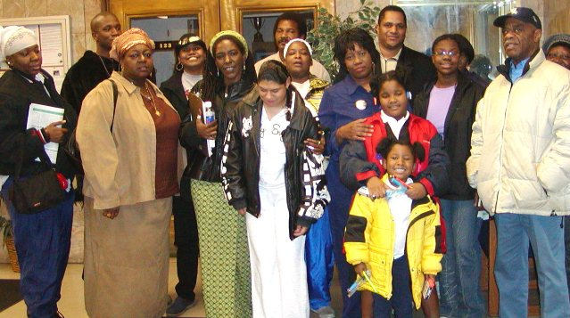 Members of the Original Detroit Coalition Against Police Brutality after they testified at a Police Commission hearing several years ago. Mailauni is at center in white dress, with her mother Lennette behind her; to her left is Arnetta Grable, and behind her is Cornell Squires. Grable spearheaded a 10-year campaign for justice for her son Lamar Grable, killed by Detroit police officer Eugene Brown in 1996.