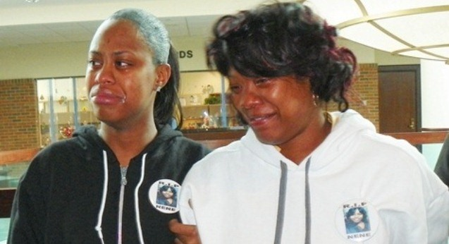 Renisha McBride's mother Monica McBride (r) and sister grieve after preliminary exam victory against her killer Theodore Wafer Dec. 19, 2013.