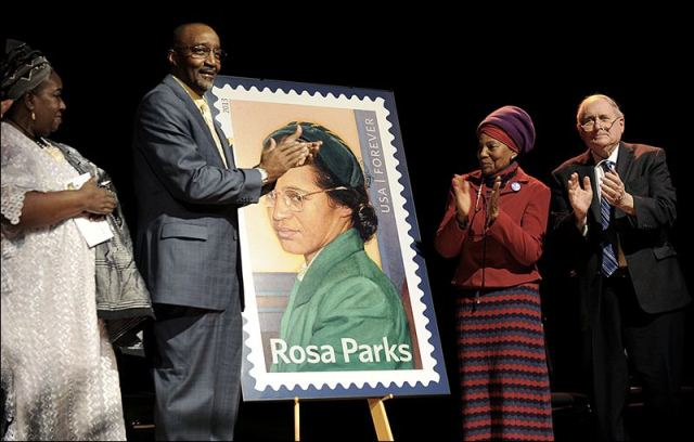 Then Detroit Councilwoman Joann Watson, from left, Lloyd Wesley, Jr., Detroit postmaster, Elaine Eason Steele, co-founder of the Rosa and Raymond Parks Institute for Self Development, and Sen. Carl Levin applaud at the unveiling of the Rosa Parks' 100th birthday commemorative postage stamp at the Museum of African American History in Detroit today.  ASSOCIATED PRESS
