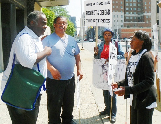 AFSCME Co. 25 Pres. Al Garrett (l) confronts protesters, speaking here with Ezza Brandon (l).
