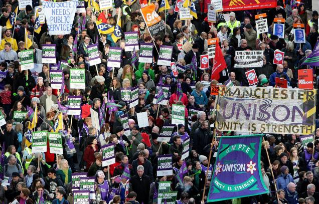 A file picture shows British Public sector workers march through the city center of Manchester, England as workers around the country stage the biggest general strike for decades in a row over pensions.