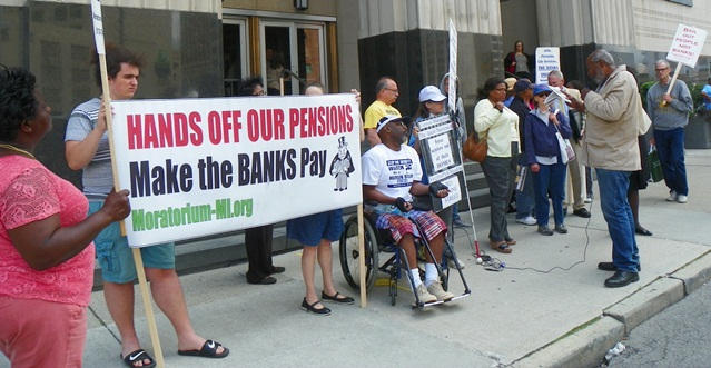 Detroit bankruptcy protesters listen to Abayomi Azikiwe during lunch break outside federal court July 15, 2014.