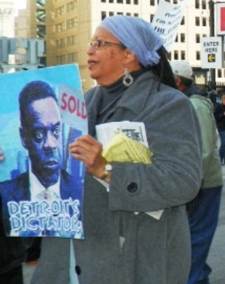 "Protester at bankruptcy court April 1, 2014 carries depiction of ""Dictator"" Kevyn Orr."