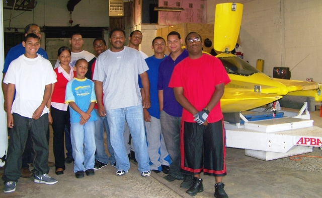Detroit's own champion hydroplane racer, Jerry Bell (center in light blue T-shirt) with his 2008 crew, made up of Golightly students.