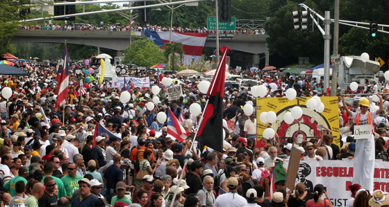 (October 15th, 2009) Thousands of protestors flooded the streets in the largest public gathering in Puerto Rican history.  The massive strike was in response to the republican governor Luis Fortuño's decision to lay off 16,720 public workers.  ~ San Juan, Puerto Rico ~ Photo © 2009 Ricardo Figueroa