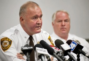 St. Louis County Police Chief Jon Belmar (left) talks about the fatal shooting of unarmed teen Michael Broown as Ferguson Police Chief Thomas Jackson listens during a news conference Sunday in Missouri.