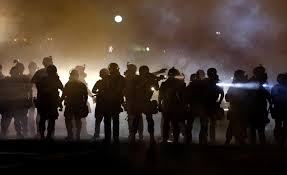 Ferguson Police line up to confront protesters in the street Aug. 15.