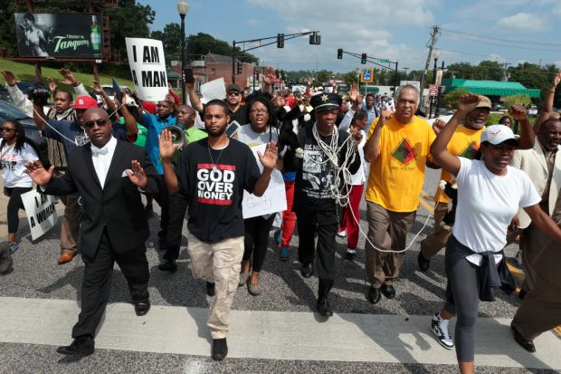 Marchers move south on S. Florissant Road in downtown Ferguson on Monday, Aug. 11, 2014 as they demonstrate at police headquarters against Saturday's police shooting of Michael Brown. Photo by Robert Cohen, rcohen@post-dispatch.com