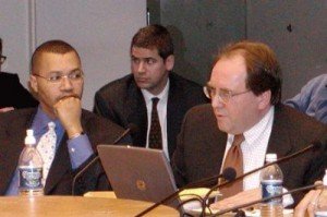 Former Detroit CFO Sean Werdlow (l) at council hearing on $1.5 B COPs loan Jan. 31, 2005. Speaking in support of deal in Joe O'Keefe of Fitch Ratings. Bill Doherty of SBS is in center, Photo: Diane Bukowski