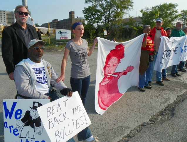 (L to r) Baxter Jones, Rev. Bill Wylie-Kellerman, and Marian Kramer (at far end of banner) were among those arrested during second Homrich water shut-offs blockade July 18, 2014.