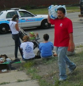 UAW member answers call to aid protesters, bringing water to Homrich blockade.