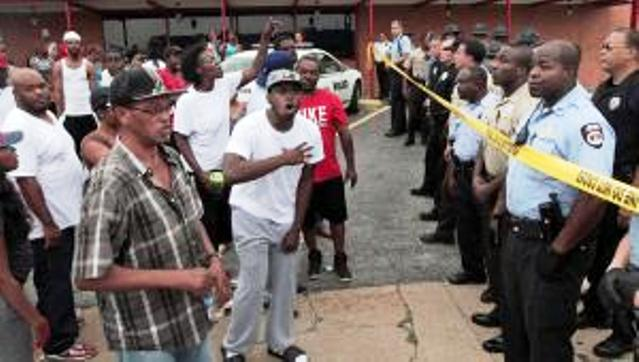 Angry crowd of hundreds confronts police in St. Louis, MO suburb after officer shot unarmed teen Michael Brown to death Aug. 9, 2014. His grandmother, who he was going to visit, saw Brown walking down the street then came upon his body. He was about to start college.