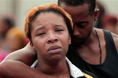 Lesley McSpadden is comforted by her husband Louis Head after their son Michael Brown was killed by police