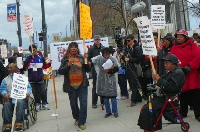 Gwen Mingo (center) speaks during large protest against Detroit bankruptcy May 1, 2014.