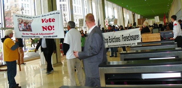 Protesters at May Day march against bankruptcy  took over Chase Bank lobby.