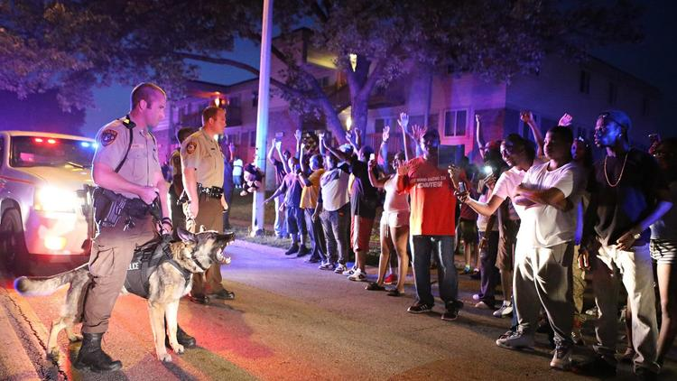 Michael Brown crowd confronts police with dogs