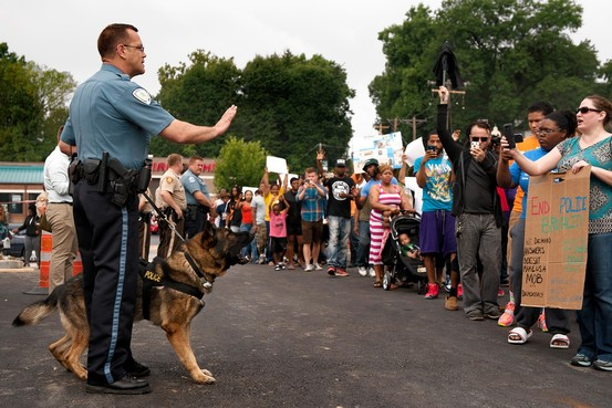 Protesters confront police in Ferguson, MO after fatal shooting of Michael Brown, 18 and unarmed.