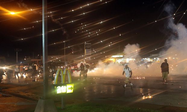 Protesters under hail of projectiles from police.
