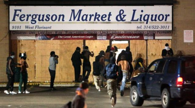 Protesters storm Ferguson store where Michael Brown accused of stealing cigars.