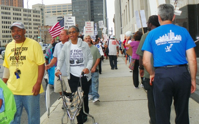 Retirees and supporters march outside bankruptcy court as plan confirmation trial begins Sept. 2, 2014.