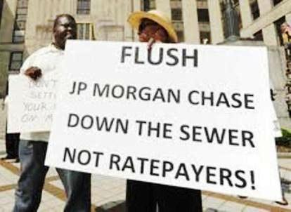 Protesters in Birmingham, Ala. protest higher rates imposed in Jefferson County bankruptcy, even though Chase was forced to take 75% debt cut.