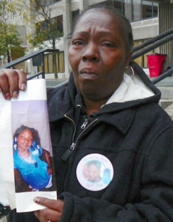 Mertilla Jones, grandmother of Aiyana, weeps as she shows the child's photo before hearing on the cop who killed her October 29, 2012.