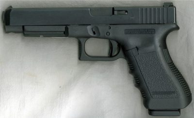 A 40 caliber Glock. Smothers said he carried this type of gun and another gun into Glover bedroom.