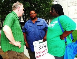 Riehl consults with local union members including Local 207 VP Lakita Thomas during protest Aug. 2, 2012.