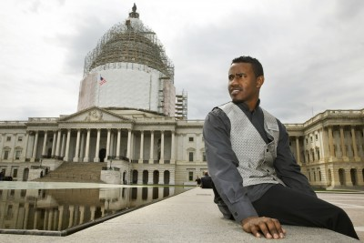 In this photo take on Friday, May 1, 2015, Abraham Tesfahun, 21, who works in food service at the Senate and makes $10.70 an hour, poses for a portrait at the Capitol in Washington. Income inequality is more than a political sound bite to workers in the Capitol. It's their life. Many of the Capitol's food servers, who make the meals, bus the tables and run the cash registers in the restaurants and carryouts that serve lawmakers, earn less than $11 an hour. Some make nothing at all when Congress is in recess. (AP Photo/Jacquelyn Martin)