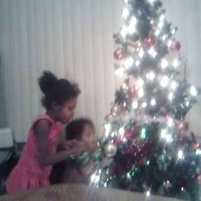 Young Aiyana with little brother during a happier Christmas before she was killed at the age of 7 by Detroit cop Joseph Weekley, Jr.