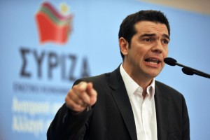 Greek leader Alexis Tsiparas in front of his party's flag, is trying to sell new austerity measures to his parliament.