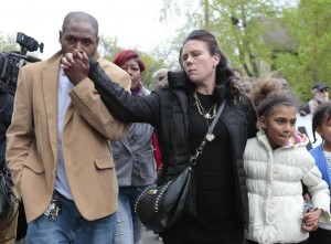 Jeff Jackson, left, comforts his girlfriend, Andrea Irwin, the mother of Tony Robinson, while escorting her during a protest march on Williamson Street, Tuesday, May 12, 2015, in Madison, Wis.  (M.P. King/Wisconsin State Journal via AP)