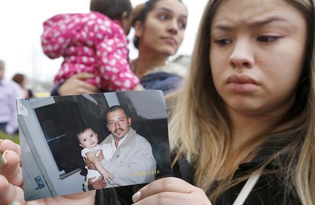 Niece shows photo of Antonio Zambrono Montes during protest.