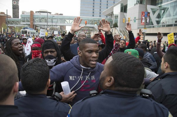 Protesters confront police April 25. AP photo.