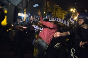 Baltimore police brutalize a demonstrator during the days of protest after Freddie Gray