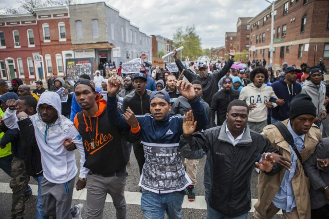 APRIL 22: Hundreds of people march through the streets of Baltimore to seek justice for the death for Freddie Gray who died from injuries suffered in Police custody in Baltimore, USA on April 22, 2015. (Photo by Samuel Corum/Anadolu Agency/Getty Images)