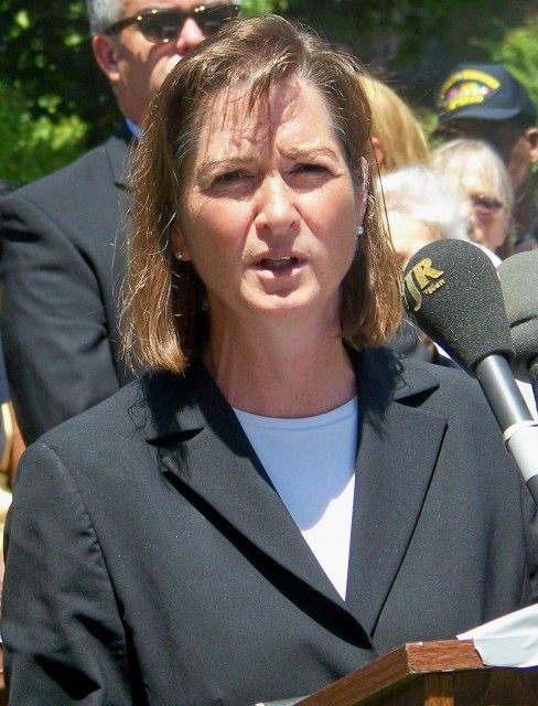 U.S. Attorney Barbara McQuade at Detroit police press conference June 30, 2013. The FBI, under the Justice Dept., had just assassinated Black Muslim leader Imam Luqman Abdullah in Dearborn in 2009.