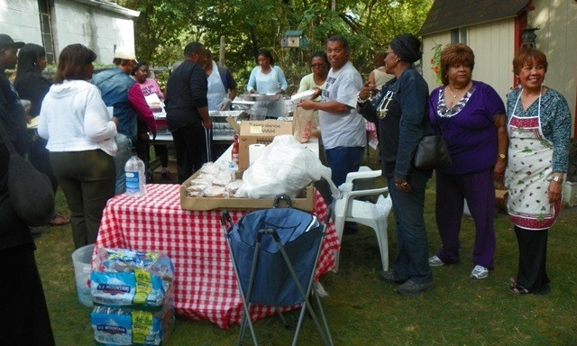 Belinda (in purple at right) worked on fish fry fundraiser for DAREA, always devoting her time and skills to the struggle.