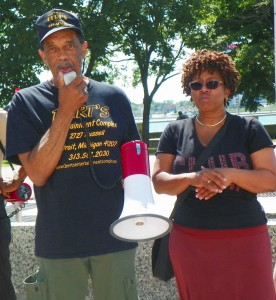Bert Dearing, Jr. (l) speaks at rally in Hart Plaza July 21, 2015, as Bert's Marketplace was being auctioned off.