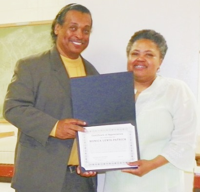 DAREA Pres. Bill Davis presents award to activist Monica Lewis Patrick of We the People of Detroit at DAREA prayer breakfast June 27, where petition campaign to save DWSD was kicked off.
