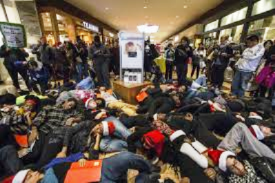 "Protesters occupy suburban St. Louis mall on ""Black Friday"" to protest grand jury verdict on police murder of Michael Brown, 18, in Ferguson, MO Aug. 9, 2014."