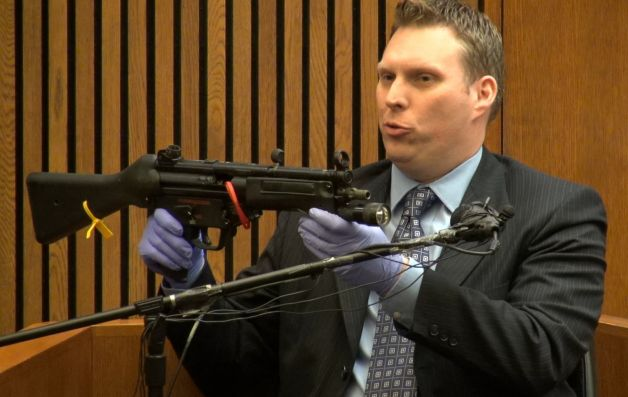 Brent Sojea, weapons expert, demonstrates MP5 semi-automatic machine gun which killed Aiyana during Weekley's earlier trial. He testified Sept. 23 again that the gun could not have fired accidentally.
